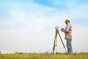 Surveyor doing field measurements